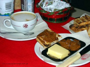 Typical breakfast with cafe au lait, toast, butter and dulce de leche